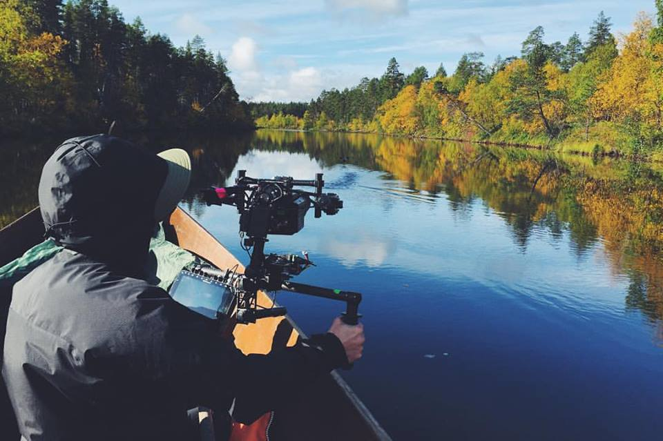 cameraman from local production crew on river in Lapland
