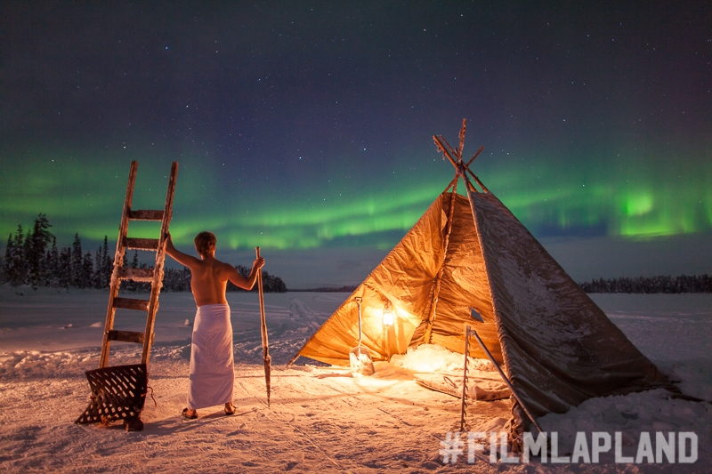 Northern Lights above a wilderness tent with Harriniva Safaris