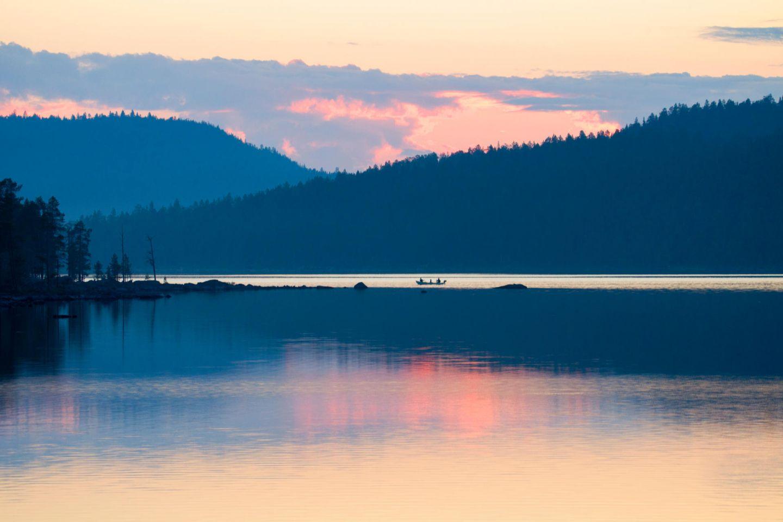Arctic lake and midnight sun