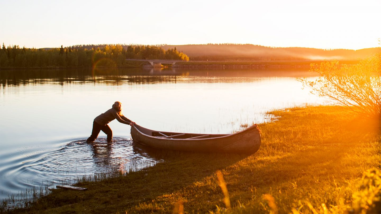 Summer in Lapland, midnight canoeing