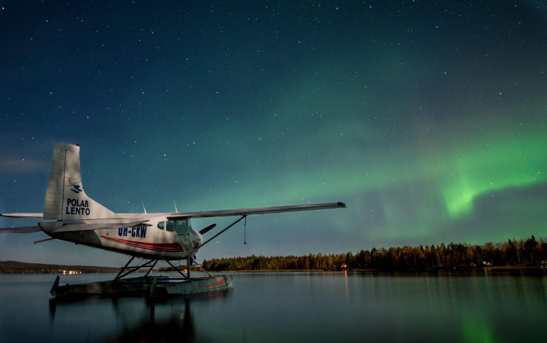 seaplane under the auroras