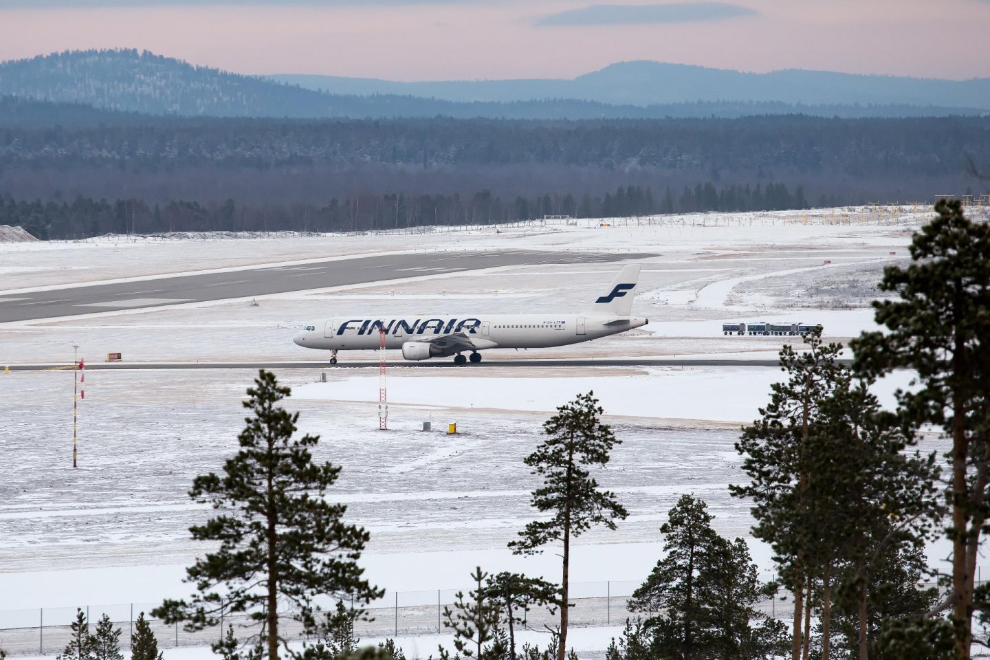Ivalo airport and airplane, with fells in the distance