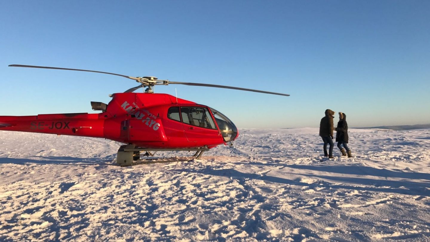 A helicopter on the snow during production of Bachelor season 21 in Lapland