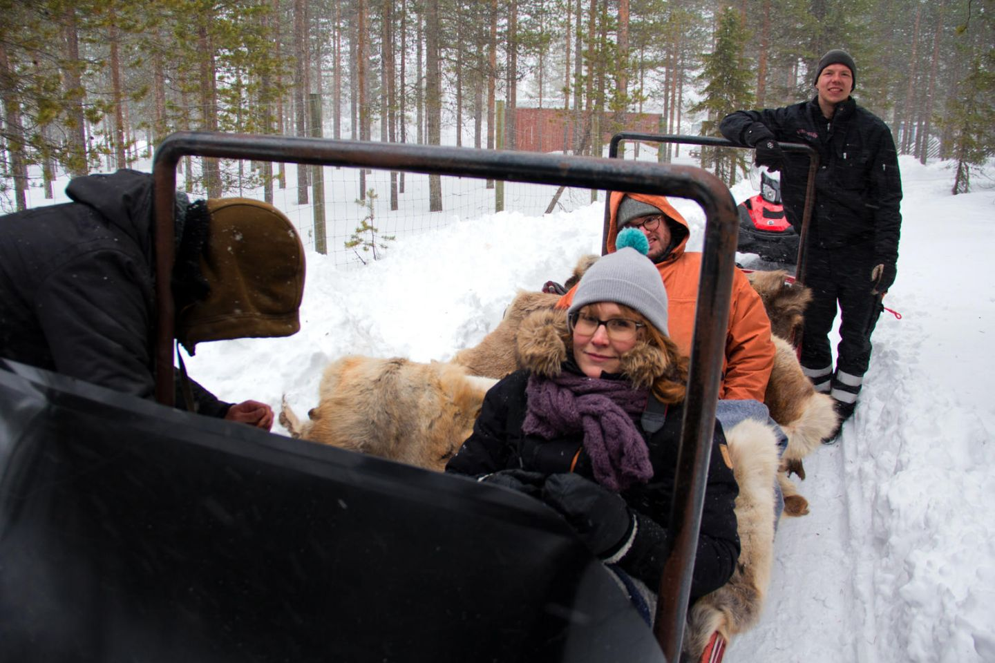 Filming a reindeer ride through the forest for French travel tv show