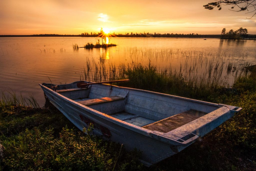 old boat & sunset in Lapland