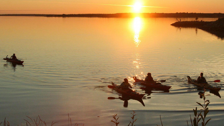 kayaks at sunset   finland summer