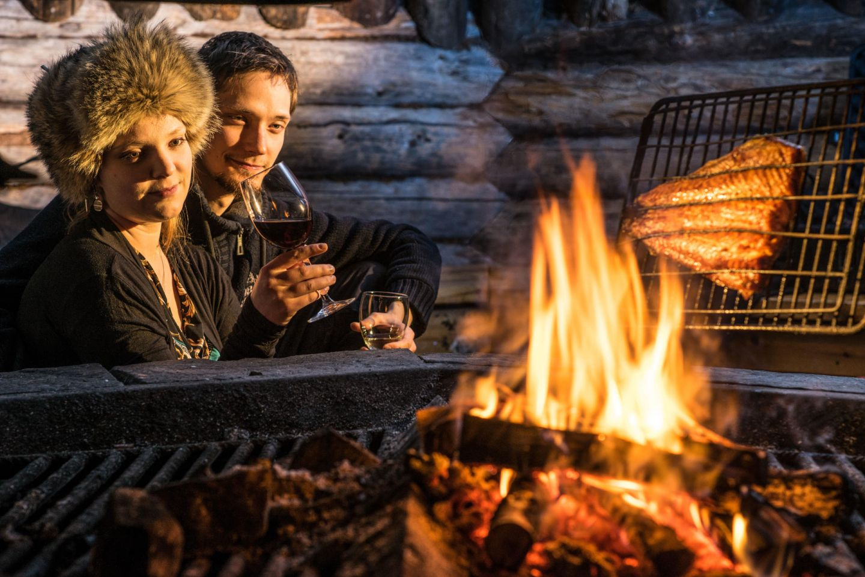 Enjoying the warm fire at Tundrea, in Kilpisjärvi, Finland