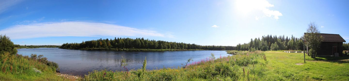 Panorama of water and buildings at Elves Hideaway in Lapland