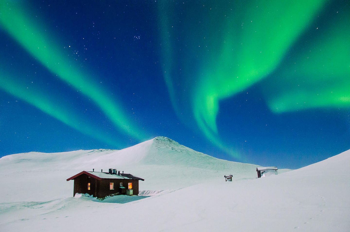 Auroras over a cabin in Lapland