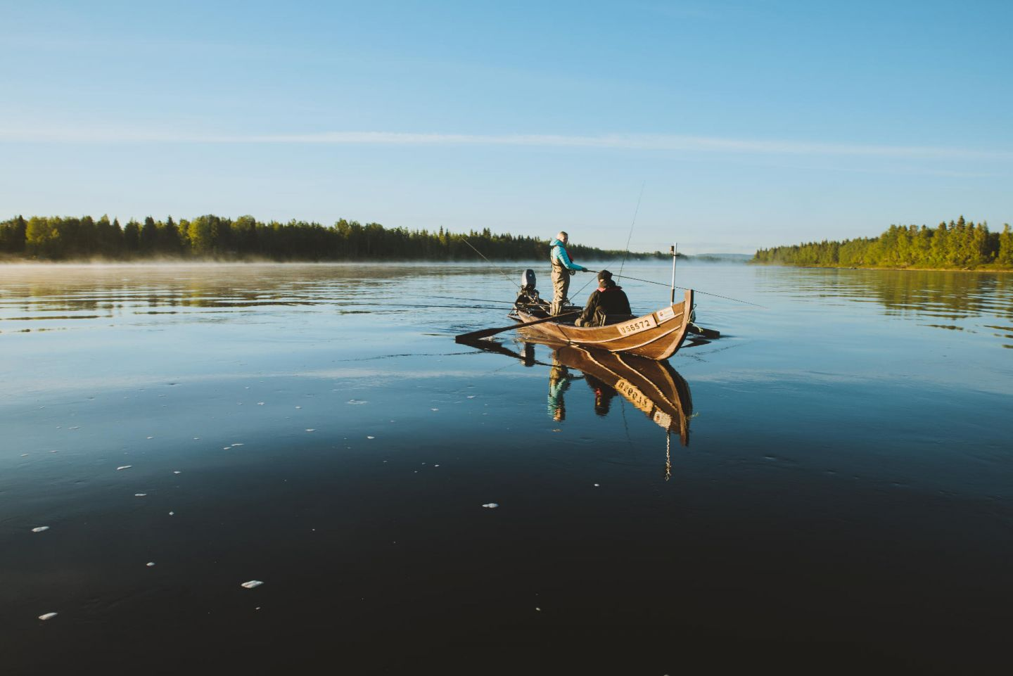 Fishing from rowboat in Pello, Finland in summer