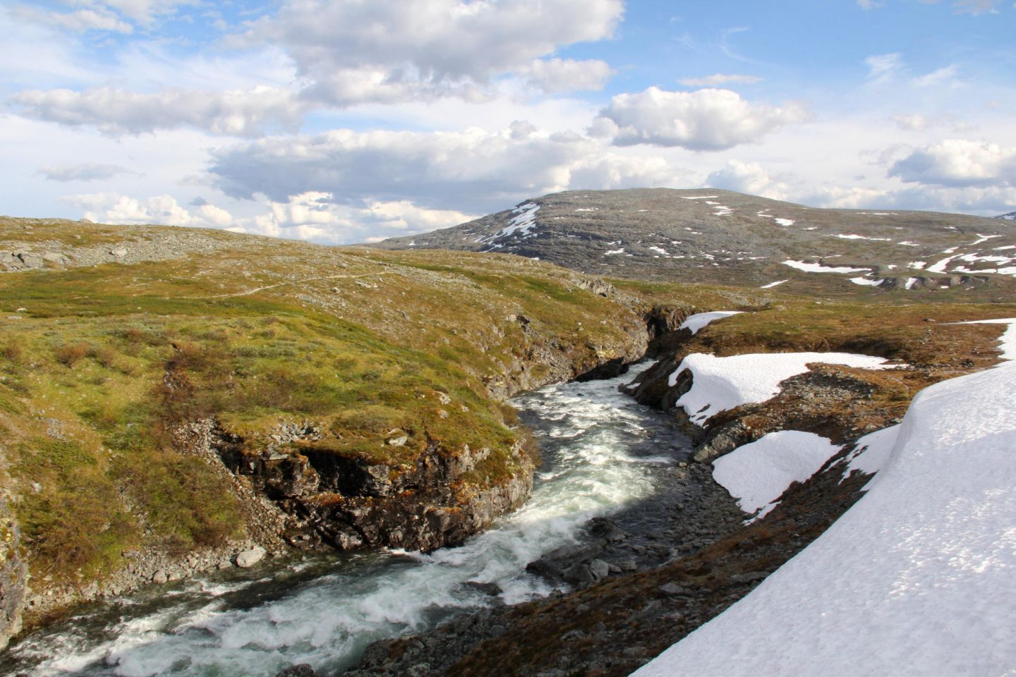 Arctic river with snow