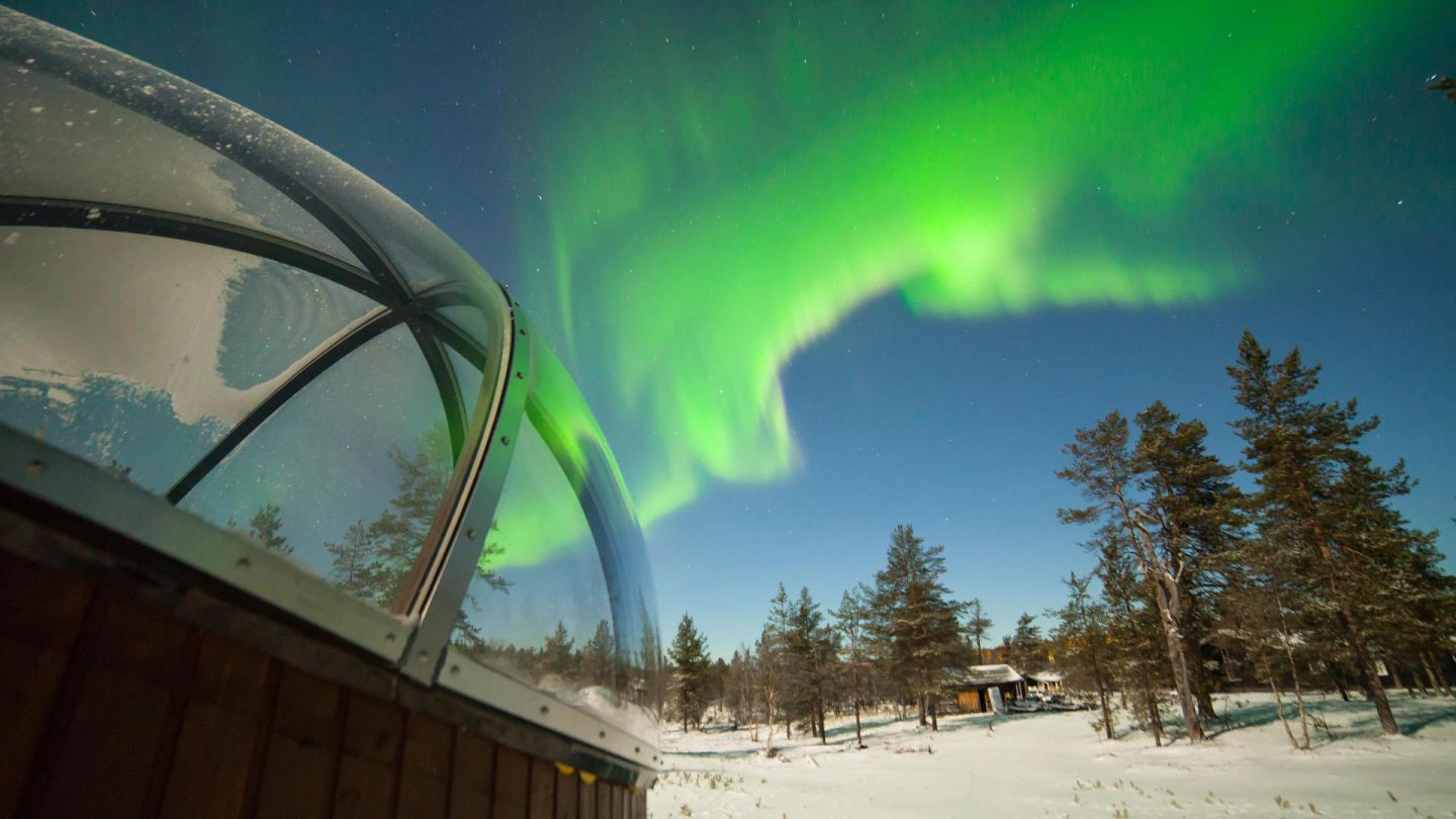 Northern Lights over aurora bubbles at Hotel Nellim