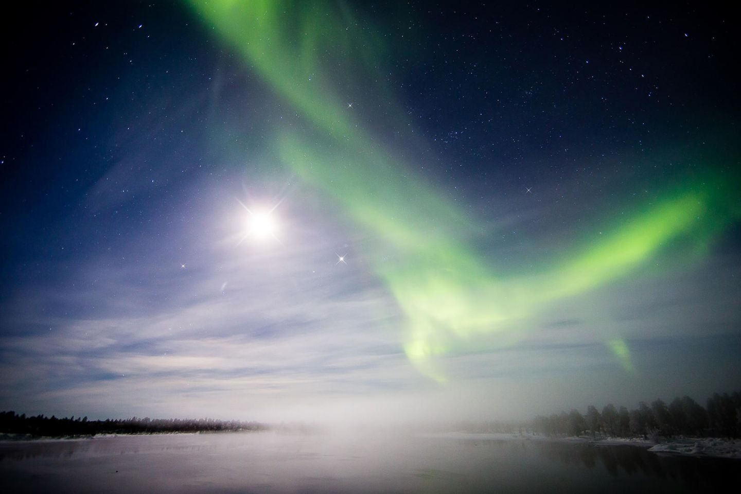 Northern Lights with the moon light in Lapland
