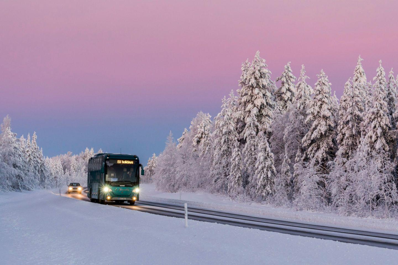 Charter bus travels through Ranua, Finland