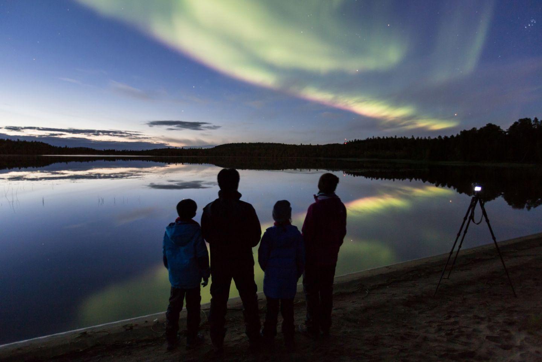 Enjoying the northern lights over Inari-Saariselkä, Finland in autumn