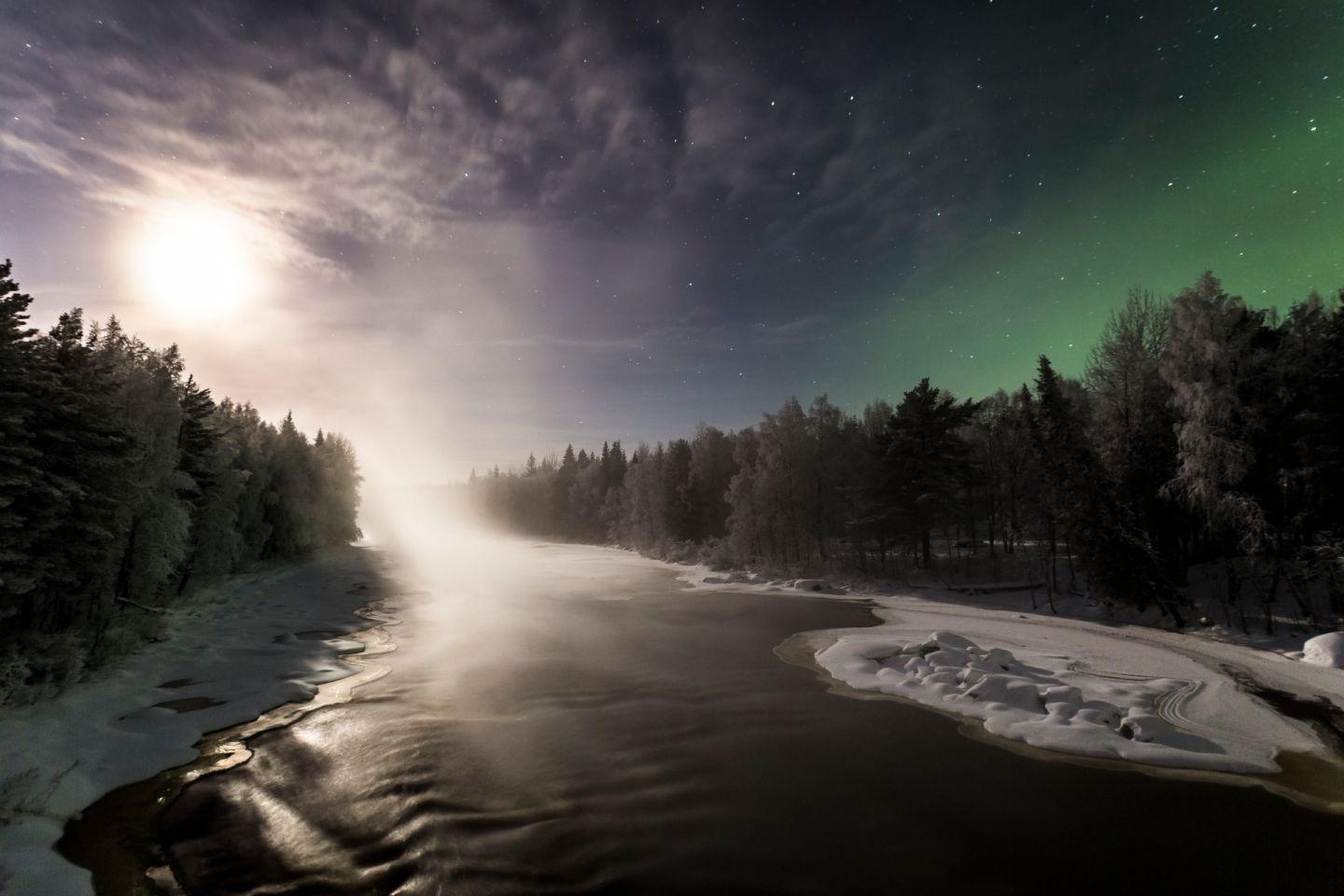 Northern Lights over a river in Finnish Lapland
