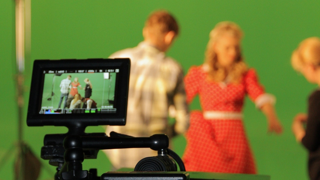 actors in front of a green screen