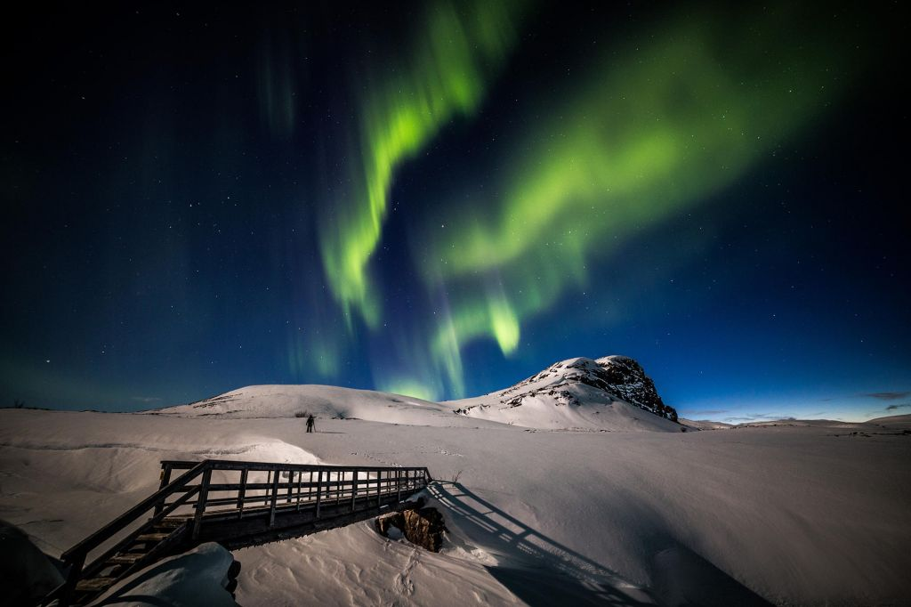 Northern Lights over Arctic landscape in winter