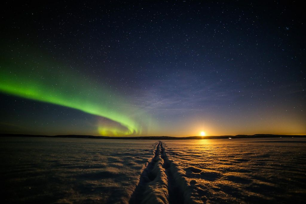 Northern Lights above a frozen lake in Finland in winter