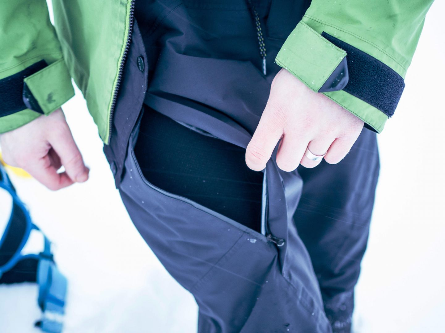 Winter pants often have easy access to inner pockets
