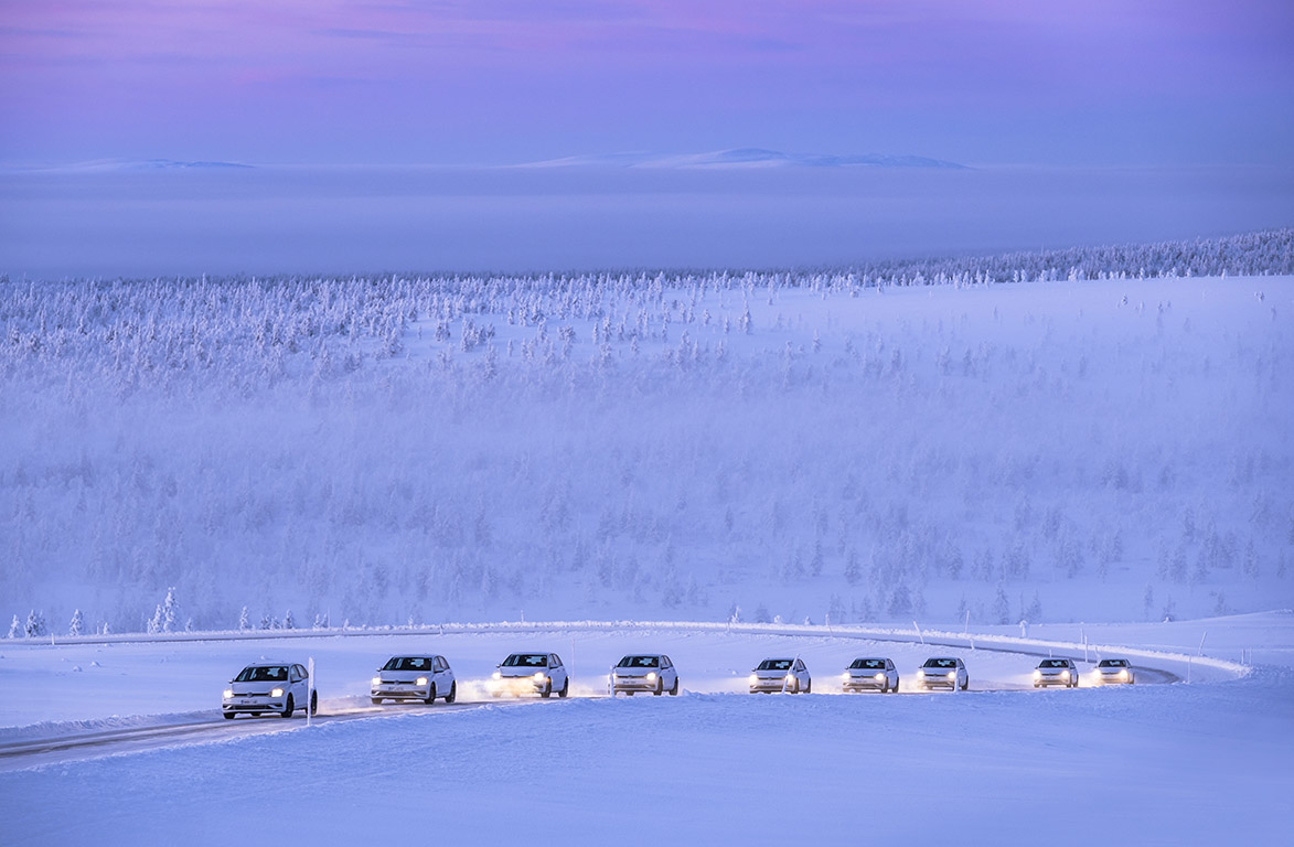 Cars drive along ice track at Test World in Inari, Lapland