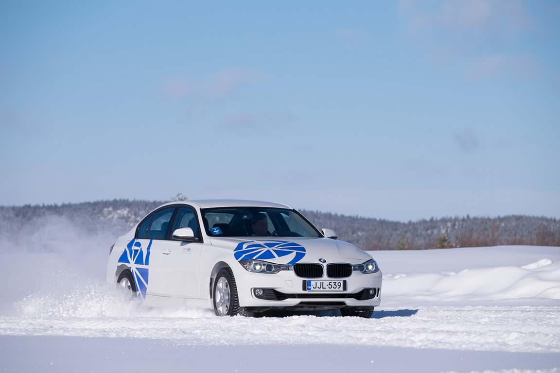 car speeding across the snow at Test World in Inari, Finland