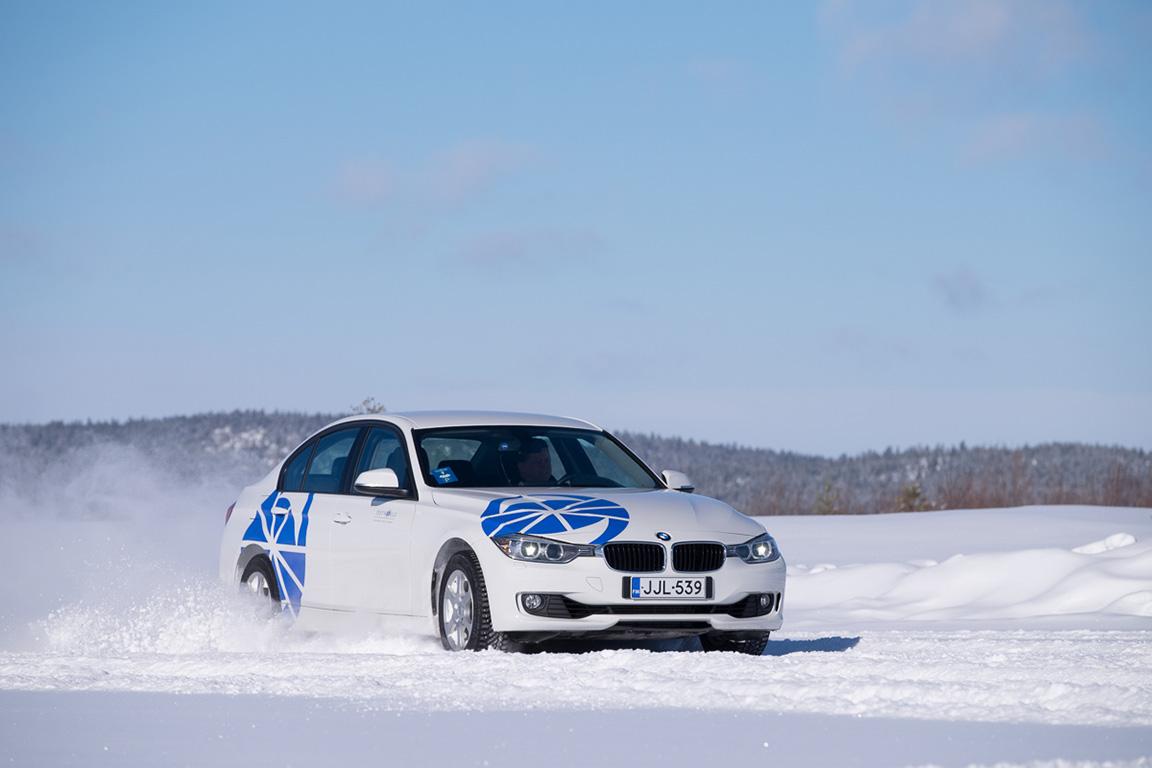 car speeding across the snow | film support services ice tracks
