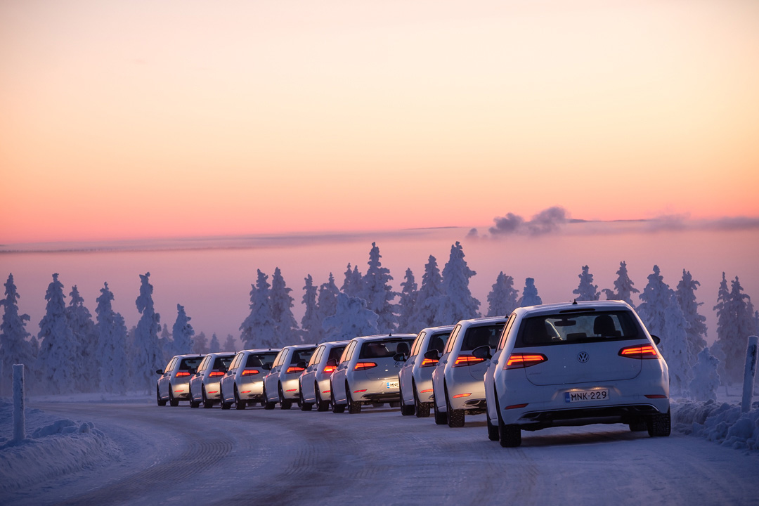 Line of cars on winter track at Test World in northern Finland