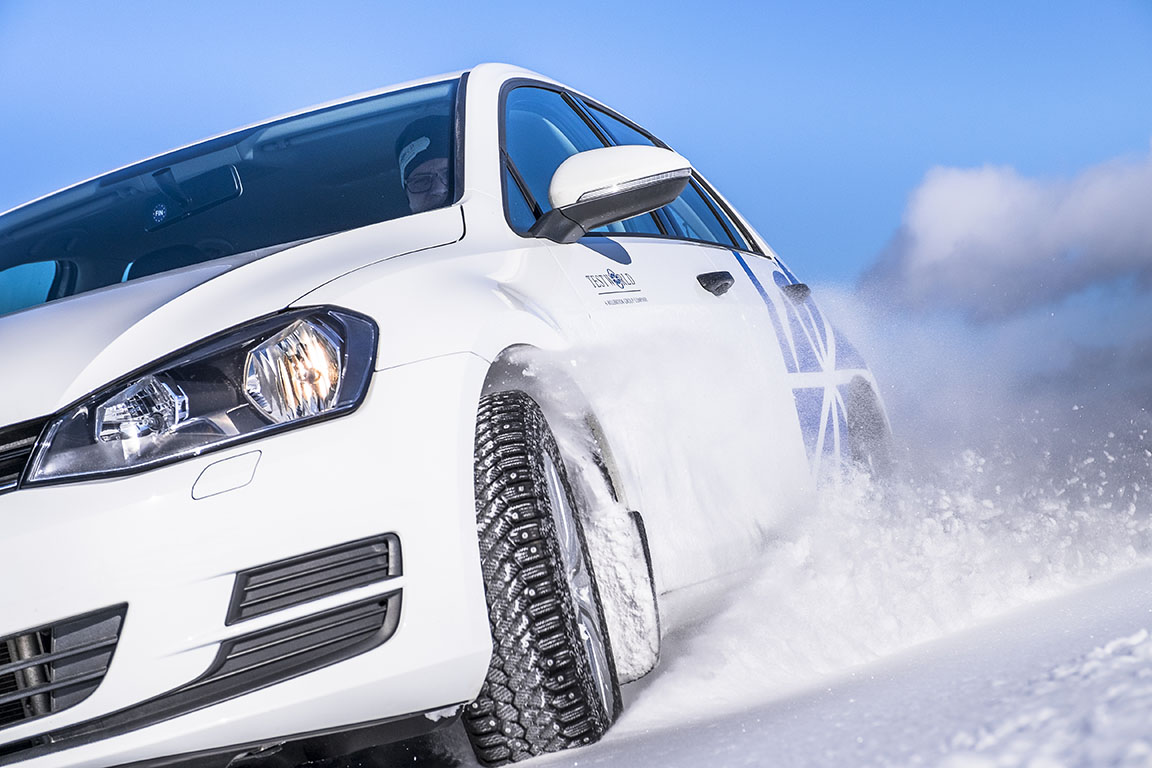 Close-up of car driving on snow track in Inari, Finland at Test World