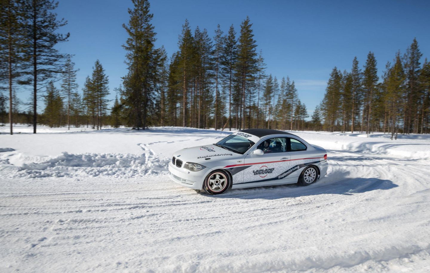 Car on snow track at Lapland Driving