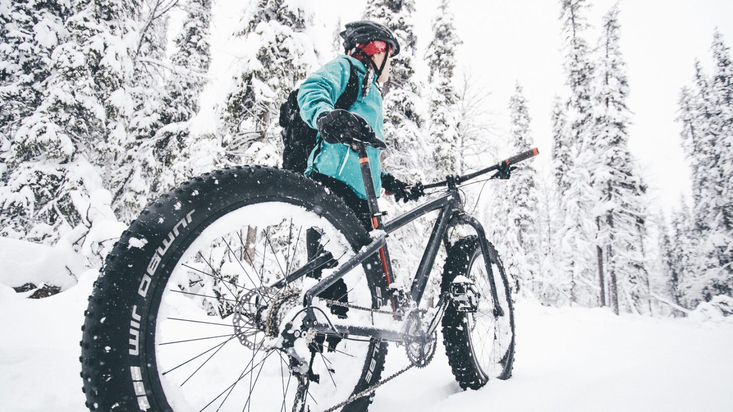 Fat-biking through heavy snow in Ylläs, Lapland in winter
