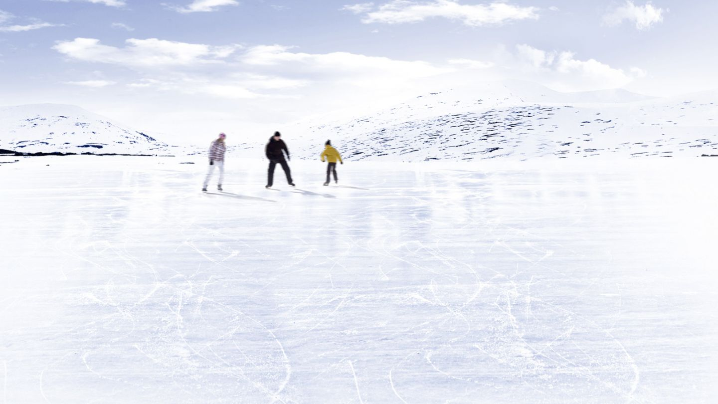 Ice skating on a frozen Lapland lake in spring in Finland