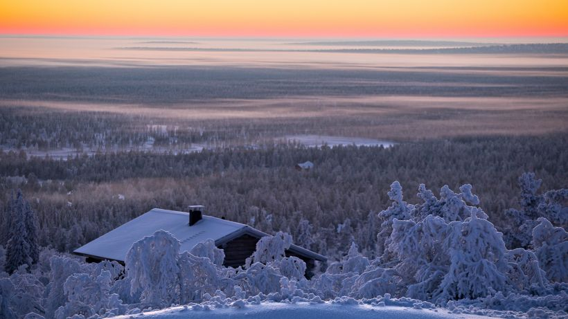 Sunset holiday cabin in Saariselka in winter