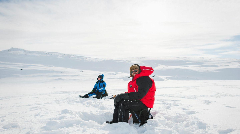 Ice-fishing under the Lapland winter sun