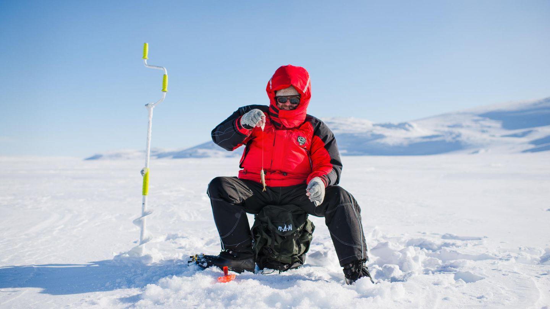 Ice fishing under the Lapland winter sun