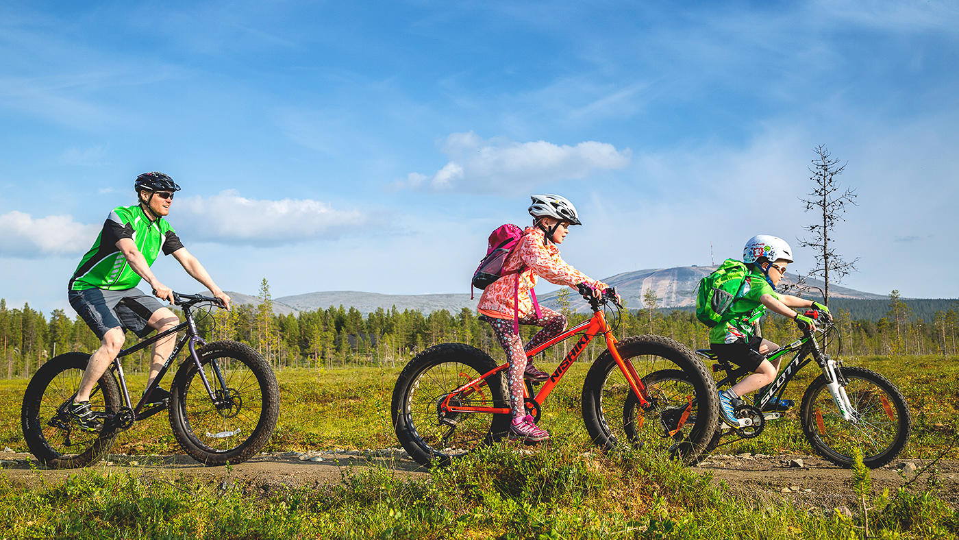 Cycling under the summer sun in Lapland