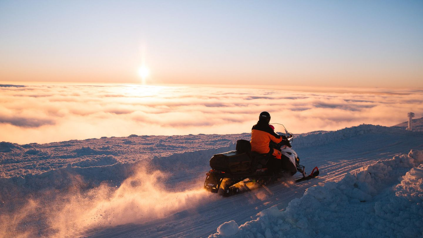 Snowmobiles during spring sunrise in Lapland, Finland