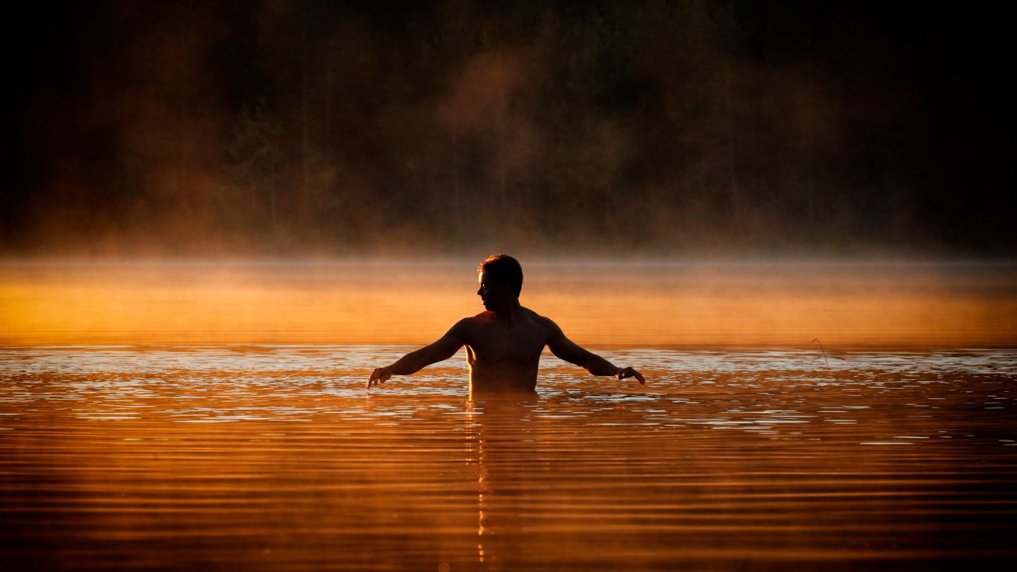 summer midnight sun swimming in Ruka, Lapland Finland