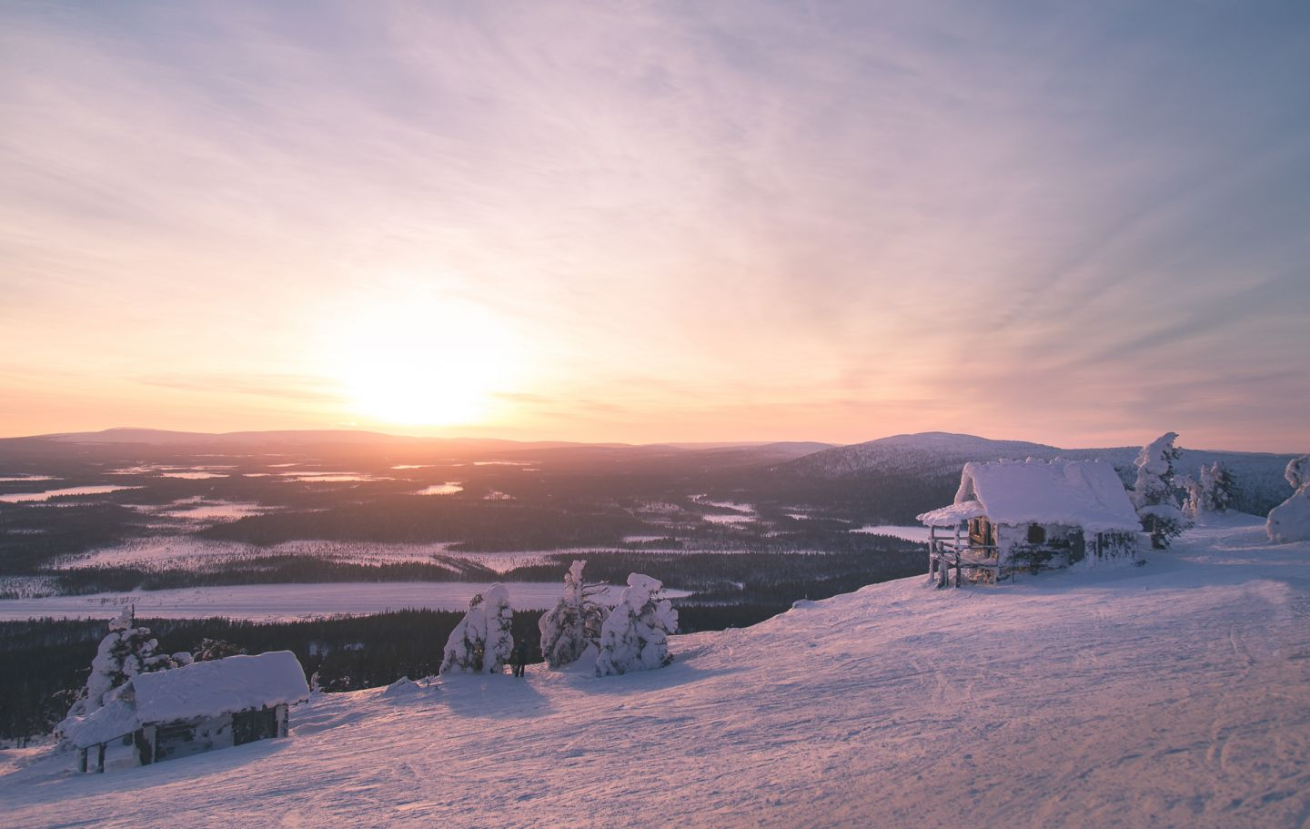 Polar night above holiday cabins in Lapland Finland
