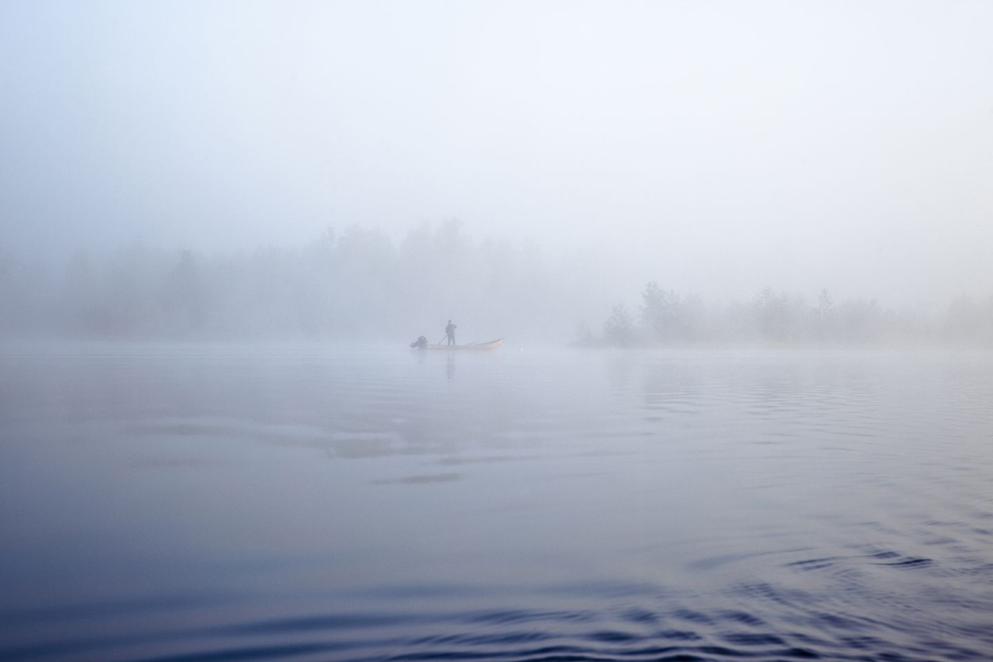 A foggy lake and a boat