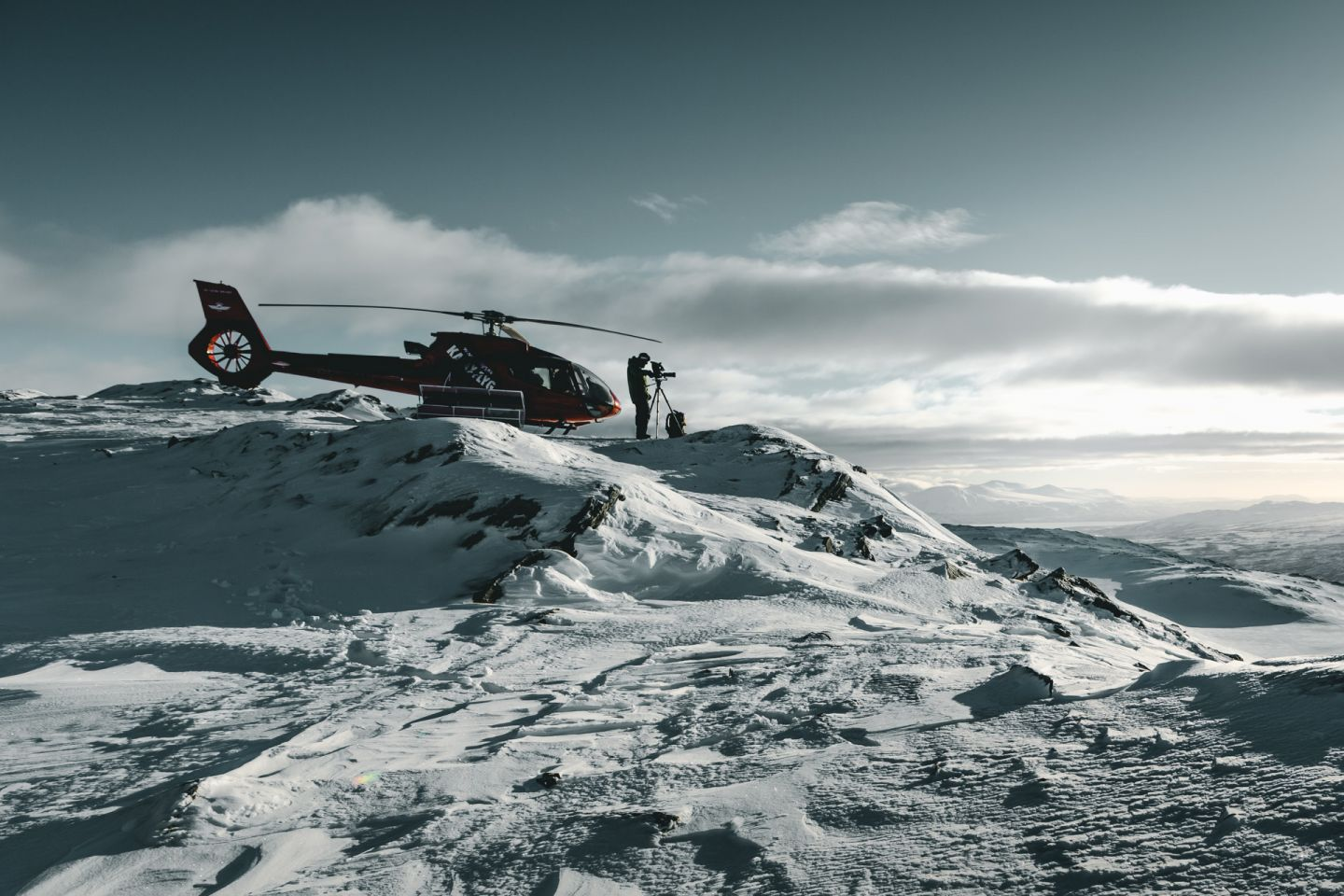 A film-friendly helicopter waits atop a fell in Lapland
