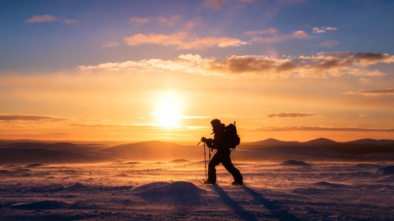 Juha Kauppinen, arctic wilderness photographer, against a Lapland sunset