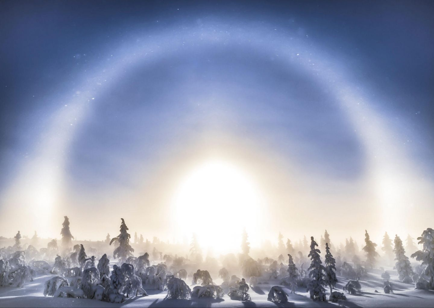 A sun halo in winter in Lapland, Finland
