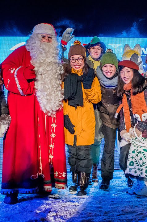 Santa Claus with tourists in Lapland