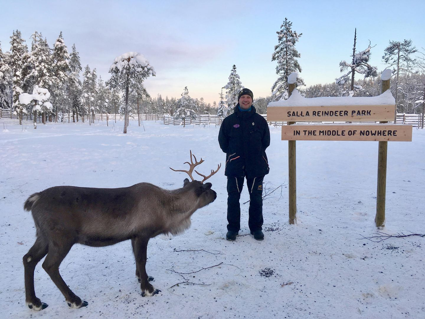 Jarko next to a signpost in the middle of nowhere (Salla, Lapland)
