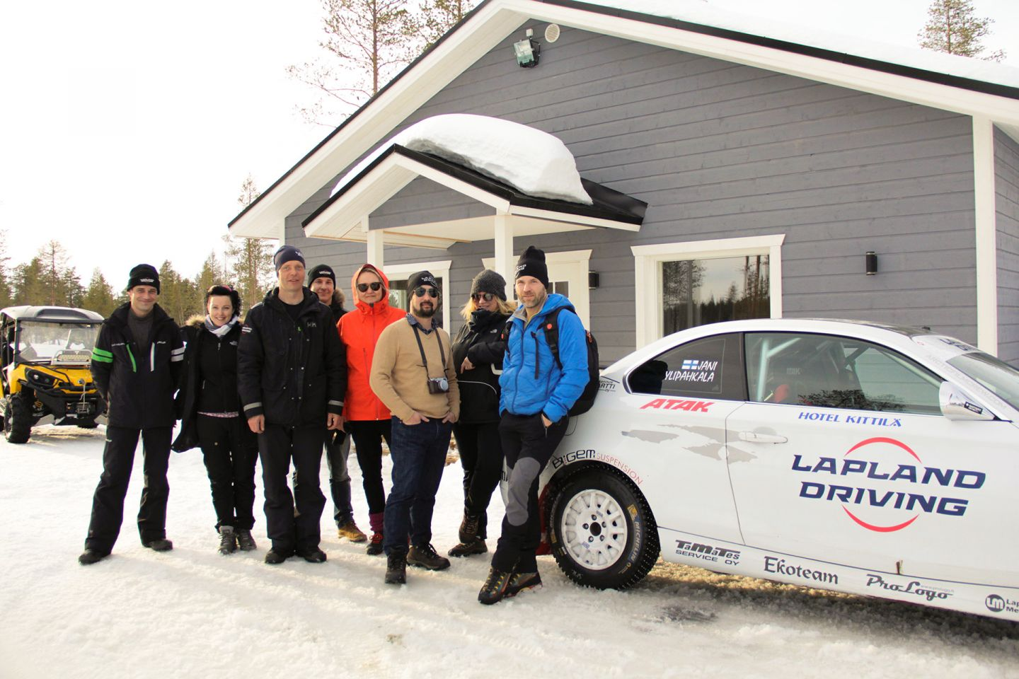 Posing next to a rally car in Levi, during Film Lapland Fam Tour 2018