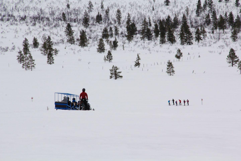 Snowmobiling across Arctic wilderness, during Film Lapland Fam Tour 2018