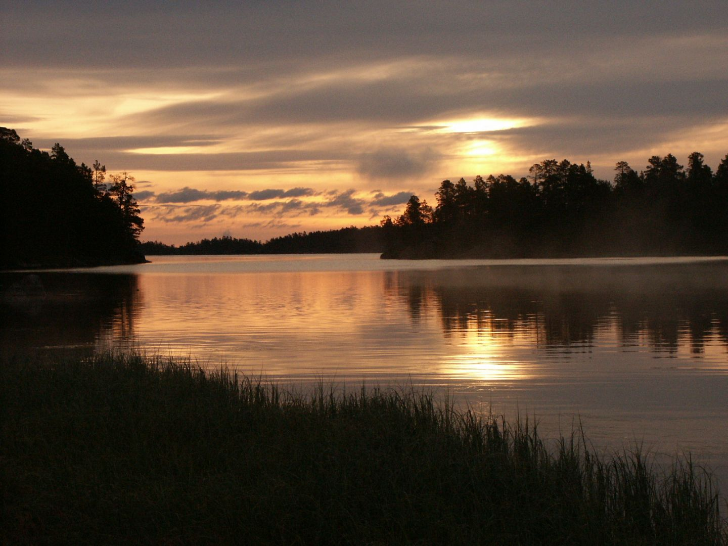 Sunrise over Lapland waters