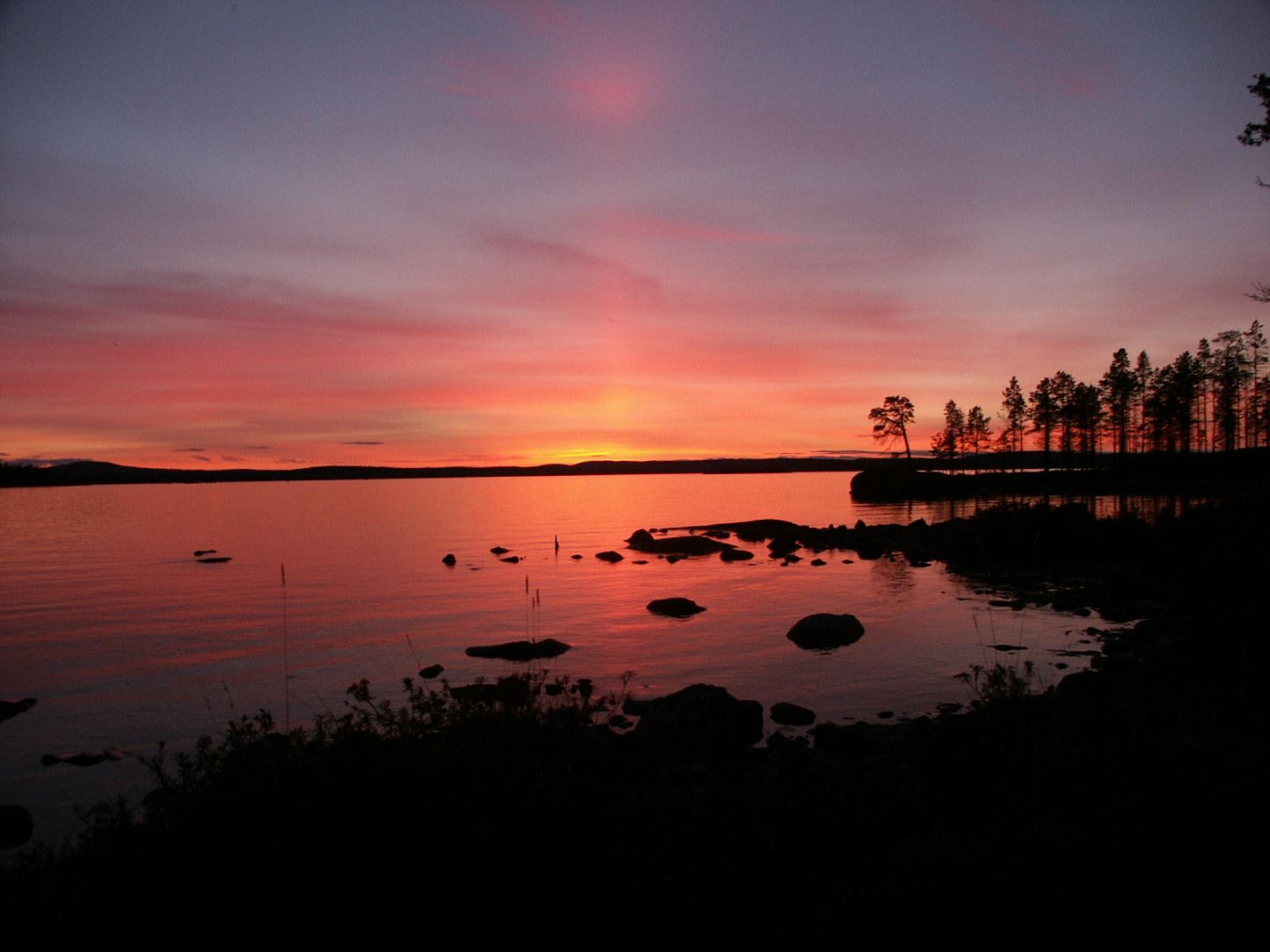 Sunset over Lapland waters