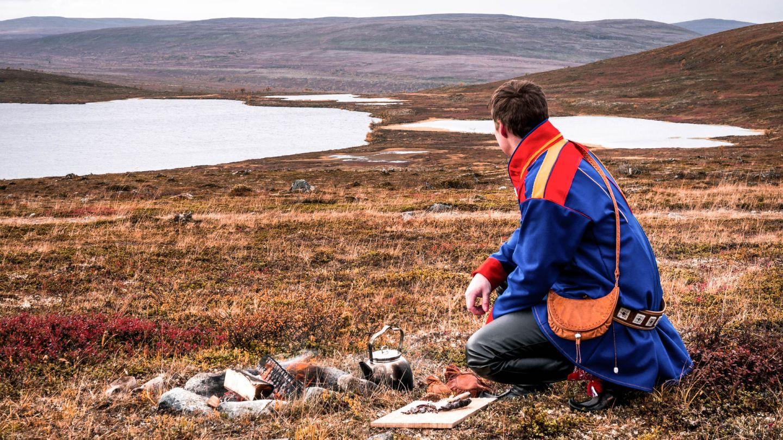 Sami reindeer herder in wilderness